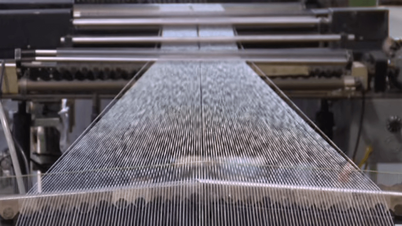 fabric being produced in a mill
