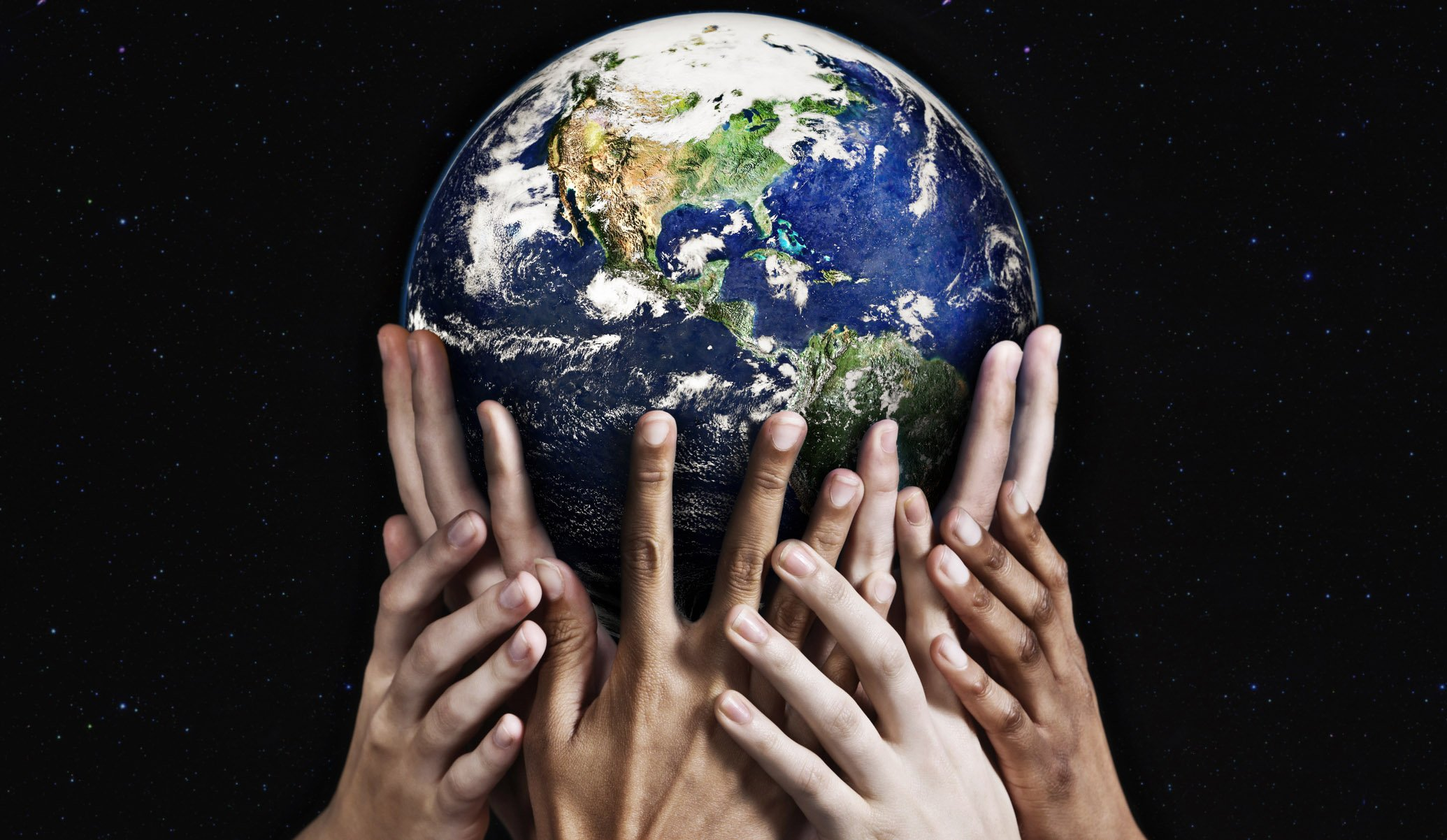 human hands supporting the earth